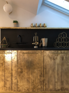 Custom Brass Fronts + Black Surfaces